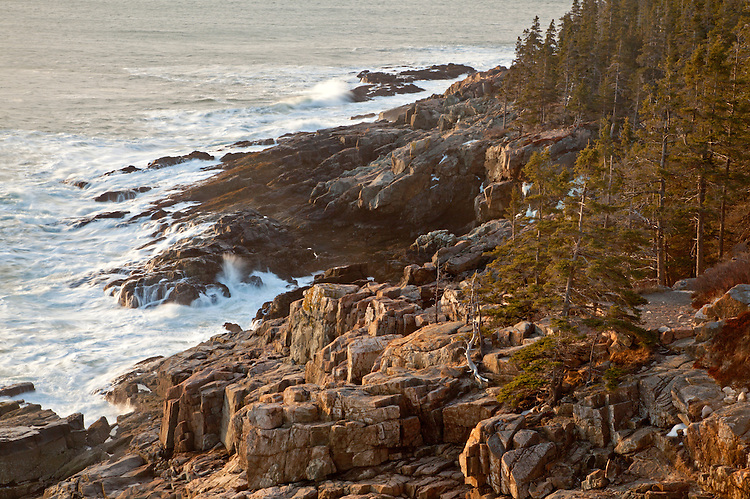 Waves crash into the granite cliffs at Otter Point along the Ocean Drive in Acadia National Park, Maine, USA