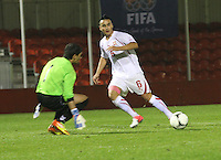 Musa Araz beats Gevorg Harutyunyan to set up a goal in the Armenia v Switzerland UEFA European Under-19 Championship Qualifying Round match at New Douglas Park, Hamilton on 11.10.12.