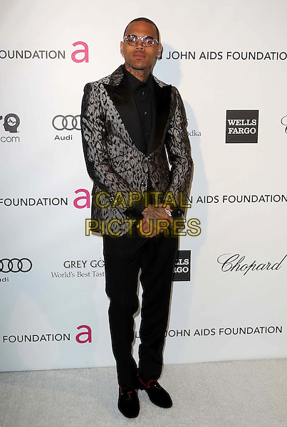 Chris Brown.The 21st Annual Elton John AIDS Foundation Academy Awards Viewing Party held at The City of West Hollywood Park in West Hollywood, California, USA..February 24th, 2013.oscars full length grey gray black shirt trousers beige leopard print suit jacket glasses .CAP/ADM/KB.©Kevan Brooks/AdMedia/Capital Pictures.