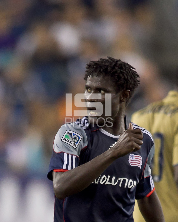 New England Revolution defender Emmanuel Osei (5) gestures to assistant referee about watching the game. The Philadelphia Union defeated New England Revolution, 2-1, at Gillette Stadium on August 28, 2010.