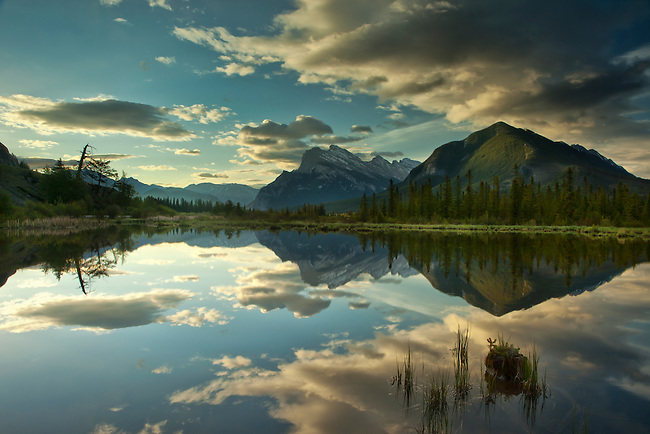 Rundle Mt is reflected in the still water of Vermilion Lake in Banff National Park Alberta, Canada.  Photo by Gus Curtis.
