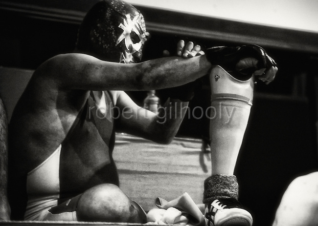 A wrestler prepares to enter the ring at Doglegs, an event for wrestlers with physical and mental handicaps in Tokyo, Japan.