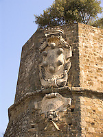 Coat of arms of the Medici family on city wall around Montalcino, Ital