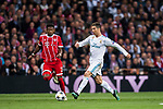 Cristiano Ronaldo (R) of Real Madrid competes for the ball with David Alaba of FC Bayern Munich during the UEFA Champions League Semi-final 2nd leg match between Real Madrid and Bayern Munich at the Estadio Santiago Bernabeu on May 01 2018 in Madrid, Spain. Photo by Diego Souto / Power Sport Images