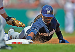 24 September 2012: Milwaukee Brewers infielder Rickie Weeks dives safely back to first during a game against the Washington Nationals at Nationals Park in Washington, DC. The Brewers fell 12-2 to the Nationals in the final game of their 4-game series, splitting the series at two. Mandatory Credit: Ed Wolfstein Photo