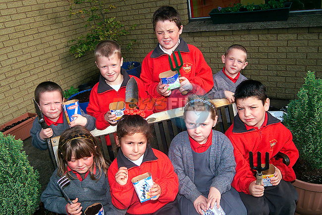 Pupils from St. Johns NS pictured planting thier trees on National Tree Planting day. Pictured are Back L/R, Andrew Starrs, Stephen Campbell, Joseph Heaney and Jack Mohan. Front L/R, Jessica Loughran, Cristianna Luciano, Rebecca Brady and Robert Smith..Picture: Paul Mohan/Newsfile