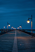Boardwalk pier at night. Cape Helopen State Park, Delaware, USA