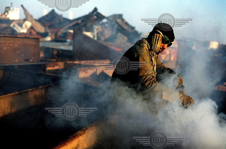 A worker at the Gaddani ship-breaking yard. The work is dirty and dangerous, the pay meager, and the job is for life, however long that may be.