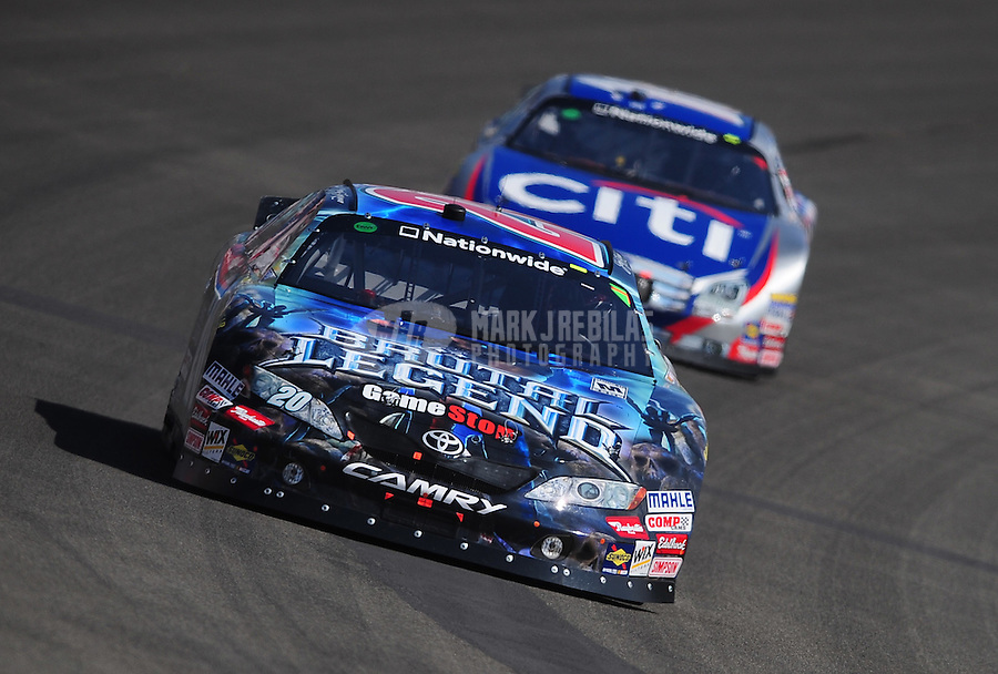 Oct. 10, 2009; Fontana, CA, USA; NASCAR Nationwide Series driver Joey Logano leads Greg Biffle during the Copart 300 at Auto Club Speedway. Mandatory Credit: Mark J. Rebilas-