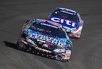 Oct. 10, 2009; Fontana, CA, USA; NASCAR Nationwide Series driver Joey Logano leads Greg Biffle during the Copart 300 at Auto Club Speedway. Mandatory Credit: Mark J. Rebilas-