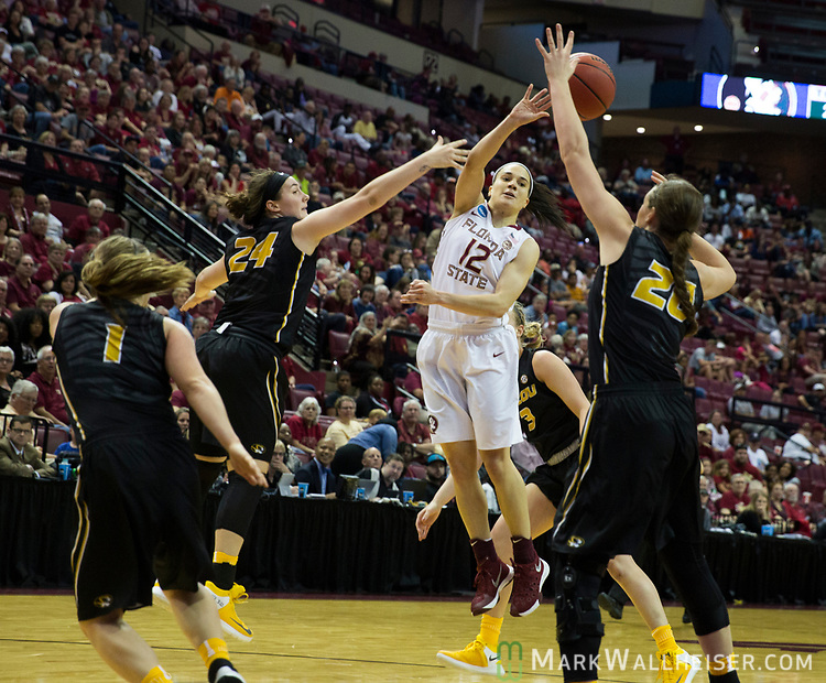 Florida State guard Brittany Brown passes against Missouri during the second half of a second-round game of the NCAA women's college basketball tournament in Tallahassee, Fla., Sunday, March 19, 2017. Florida State defeated Missouri 77-55. (AP Photo/Mark Wallheiser)