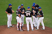 Buffalo Bisons manager Ken Oberkfell makes a pitching change with Nick Evans, Michael Barrett, Luis Hernandez, Ruben Tejeda, Lucas Duda and Jose De La Torre during a game vs. the Lehigh Valley IronPigs at Coca-Cola Field in Buffalo, New York;  August 1, 2010.  Buffalo defeated Lehigh Valley 2-1 in 10 innings.  Photo By Mike Janes/Four Seam Images