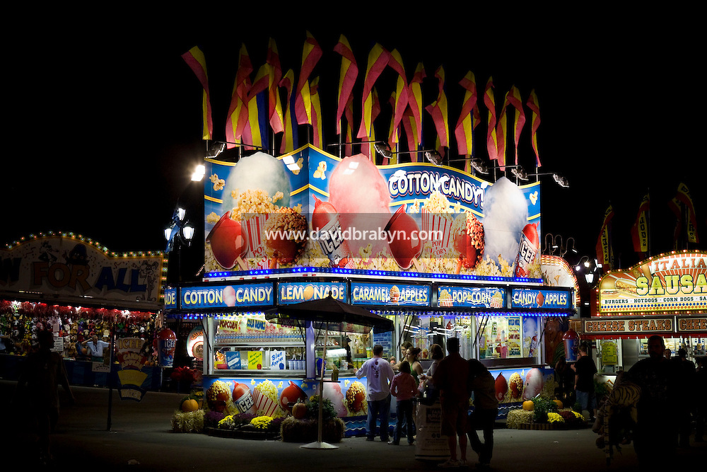 View of a food vendor stand selling cotton candy, candy apple, caramel apples, popcorn and lemonade at the North Carolina State Fair in Raleigh, NC, United States, 16 October 2008.