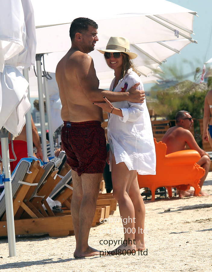 Pic shows: Exclusive all rounder <br /> <br /> Wimbledon Champion Simona Halep and her new boyfriend, Toni Iuruc kissing and cuddling on the beach in Romania<br />  <br /> <br /> <br /> <br /> <br /> <br /> <br /> <br /> <br /> <br /> pic by Bogdan Neacsu /Pixel8000