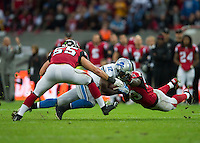 26.10.2014.  London, England.  NFL International Series. Atlanta Falcons versus Detroit Lions. Lions' WR Jeremy Ross [12] is tackled by the Falcons defence.