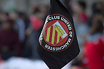 A corner flag with club crest at Broadhurst Park, Manchester, the new home of FC United of Manchester during the second-half of the club's match against Benfica, champions of Portugal, which marked the official opening of their new stadium. FC United Manchester were formed in 2005 by fans disillusioned by the takeover of Manchester United by the Glazer family from America. The club gained several promotions and played in National League North in the 2015-16 season, but lost this match 1-0.