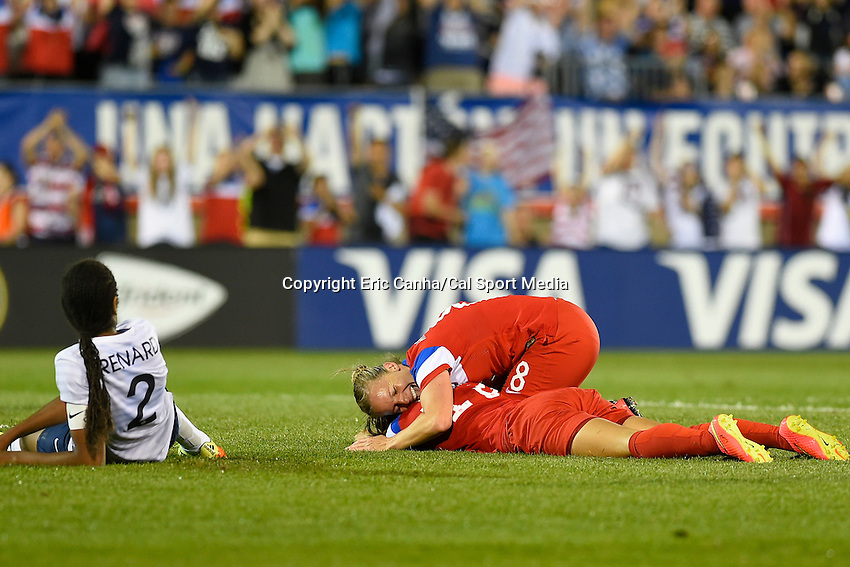 June 19, 2014 - East Hartford, Conn. U.S. - United State's Alex Morgan (13) lays on the field and is hugged by United State's Amy Rodriguez (8) after scoring a goal during the 2nd half of the USA Women's Soccer friendly game between USA and France held at Rentschler Field in East Hartford Connecticut. The match ended with a 2-2 tied score. Eric Canha/CSM
