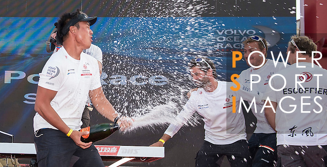 Team members receive their trophies after the In-Port Race Sanya as part the Volvo Ocean Race Leg 3 Abu Dhabi-Sanya stop-over on February 7, 2015 in Sanya, China. The Volvo Ocean Race 2014-15 is the 12th running of this ocean marathon. Starting from Alicante in Spain on October 11, 2014, the route, spanning some 39,379 nautical miles, visits 11 ports in 11 countries (Spain, South Africa, United Arab Emirates, China, New Zealand, Brazil, United States, Portugal, France, the Netherlands and Sweden) over nine months. The Volvo Ocean Race is the world's premier ocean race for professional racing crews. Photo by Victor Fraile / Power Sport Images