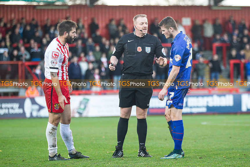 Referee Mr Trevor Kettle provides some advice to Rory Donnelly, Gillingham and Dean Wells of Stevenage during Stevenage vs Gillingham, Emirates FA Cup Football at the Lamex Stadium, Stevenage, England on 07/11/2015