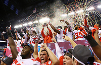 Ohio State Buckeyes head coach Urban Meyer hoists the championship trophy following the Buckeyes' 27-21 win over the Wisconsin Badgers in the Big Ten championship football game at Lucas Oil Stadium in Indianapolis on Dec. 2, 2017. [Adam Cairns / Dispatch]