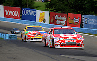 Aug. 8, 2009; Watkins Glen, NY, USA; NASCAR Sprint Cup Series driver Juan Pablo Montoya leads Kyle Busch during practice for the Heluva Good at the Glen. Mandatory Credit: Mark J. Rebilas-