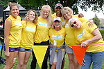 Chelanman organizer Julie Pittsinger (center with baseball cap) took the time to pose with just a few volunteers that help make the Chelanman Multisport Weekend a success every year. Volunteers come from a variety of local groups from high school sports teams to local recreation groups and organizations.