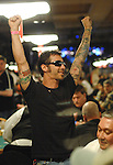 Sully Erna, singer with the rock band Godsmack, reacts to winning an all in hand.