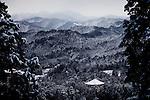 (En) January 2010 - Koyasan, Japan.  Koyasan and the Daito seen from the summit of Bentendake mount on the women path. Until 1874, women were not allowed to enter the town. They had to go round the town in the forest to reach Oku-no-In cemetery and Kukai's mausoleum. (Fr) Janvier 2010 - Koyasan, Japon. Koyasan et le Daito vus du sommet du mont Bentendake, sur le chemin des femmes. Jusqu'en 1874, l'entree dans la ville de Koyasan etait interdite aux femmes, qui devaient contourner la ville par les montagnes pour aller se recueillir devant le mausolee de Kobodaishi dans l'Oku-no-in.
