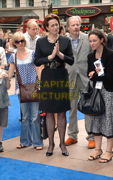 """SIGOURNEY WEAVER .Attending the UK Film Premiere of Disney Pixar's """"Wall-e"""" at Empire Cinema Leicester Square, London, England, UK, July 13th 2008..WallE Wall*e Wall.E full length black dress belt shoes hands clapping .CAP/WIZ.©Wizard/Capital Pictures"""