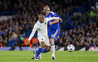 Yacine Brahimi of FC Porto and Nemanja Matic of Chelsea battle for the ball during the UEFA Champions League group G match between Chelsea and FC Porto at Stamford Bridge, London, England on 9 December 2015. Photo by Andy Rowland.