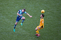 Dominic Gape of Wycombe Wanderers heads past Josh Sheehan of Newport County during the Sky Bet League 2 match between Wycombe Wanderers and Newport County at Adams Park, High Wycombe, England on 2 January 2017. Photo by Andy Rowland.