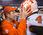 Clemson head coach Dabo Swinney talks with quarterback Deshaun Watson after defeating Alabama for the 2017 College Football Playoff National Championship in Tampa, Florida on January 9, 2017.  Clemson defeated Alabama 35-31. Photo by Mark Wallheiser/UPI