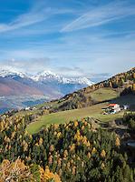 Italy, South-Tyrol (Alto Adige - Trentino), Vinschgau (Val Venosta), view from village Stelvio at Prato mountain with some mountain farms, at background snowcapped summits of Oetztal Alps | Italien, Suedtirol, Vinschgau, Blick von Stilfs auf den Prader Berg mit einigen Bergbauernhoefen, dahinter die schneebedeckten Gipfel der Oetztaler Alpen