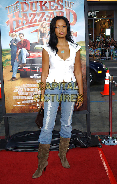 "GARCELLE BEAUVAIS-NILON.The Warner Brothers World Premiere of ""The Dukes of Hazzard"" held at The Grauman's Chinese Theatre in Hollywood, California  .July 28th, 2005.full length white sleeveless top brown suede boots jeans denim tucked in.www.capitalpictures.com.sales@capitalpictures.com.Supplied By Capital PIctures"