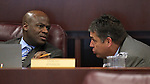 Nevada Assemblymen Kelvin Atkinson, left, D-North Las Vegas, and Marcus Conklin, D-Las Vegas, talk during a committee hearing at the Legislature in Carson City, Nev., on Monday, Feb. 21, 2011. .Photo by Cathleen Allison