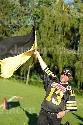 July 25-15,Stade Napoleon,Berlin,Germany<br /> GFL Nord <br /> Berlin Adler vs D&uuml;sseldorf Panther<br /> Berlin Adler fan waving his fan flag,Adler win 27:7
