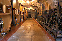 Barrels of wine aging in the cellar Piles of old bottles aging in the cellar Chateau Vannieres (Vannières) La Cadiere (Cadière) d'Azur Bandol Var Cote d'Azur France