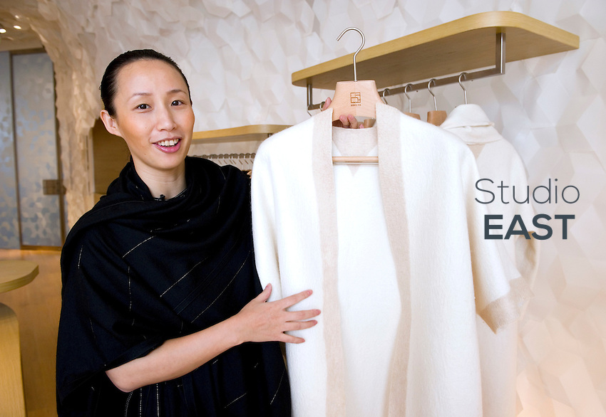 Shangxia CEO and Artistic Director JIANG Qiong Er poses with a Mongolian cashmere robe priced at 28,000 Yuans (3,200 euros) in the first store of the luxury brand, due to open tomorrow, in Shanghai, China, on September 15, 2010. Shangxia is a Chinese luxury brand launched by Hermes. Shangxia is owned by Hermes and has its own design team. It will make and sell clothes and accessories based on Chinese styles and traditional know-how. If customer reaction proves positive, Hermes plans to open a Shangxia store in Paris next year and gradually roll out worldwide. Photo by Lucas Schifres/Pictobank