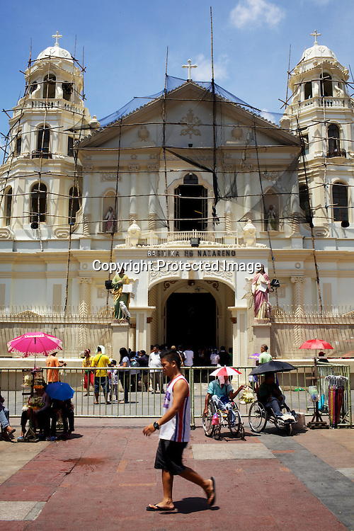 Catholics seen outside after the sunday mass at the Quiapo Church, also known as Minor Basilica of the Black Nazarene in Quiapo, Manila, in the Philippines. Photo: Sanjit Das
