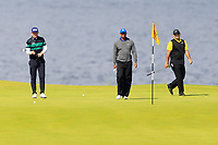 Matt Wallace (ENG) and Tiger Woods (USA) and Patrick Reed (USA) on the 5th green during 1st round of the 148th Open Championship, Royal Portrush golf club, Portrush, Antrim, Northern Ireland. 18/07/2019.<br /> Picture Thos Caffrey / Golffile.ie<br /> <br /> All photo usage must carry mandatory copyright credit (© Golffile | Thos Caffrey)