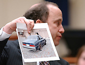 Defense attorney Peter Greenspun holds a photo of the Cheverolet Caprice used by Muhammad and Malvo during his closing arguments in the trial of sniper suspect John Allen Muhammad at the Virginia Beach Circuit Court in Virginia Beach, Virginia on November 13, 2003.<br /> Credit: Steve Earley - Pool via CNP