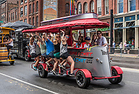 Sprocket Rocket party bike travels down Broadway, Nashville, Tennessee, USA.