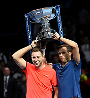 Jack Sock and Mike Bryan recieving their trophy after winning against Pierre-Hughes Herbert and Nicolas Mahut in their doubles Final match today<br /> <br /> Photographer Hannah Fountain/CameraSport<br /> <br /> International Tennis - Nitto ATP World Tour Finals Day 8 - O2 Arena - London - Sunday 18th November 2018<br /> <br /> World Copyright &copy; 2018 CameraSport. All rights reserved. 43 Linden Ave. Countesthorpe. Leicester. England. LE8 5PG - Tel: +44 (0) 116 277 4147 - admin@camerasport.com - www.camerasport.com