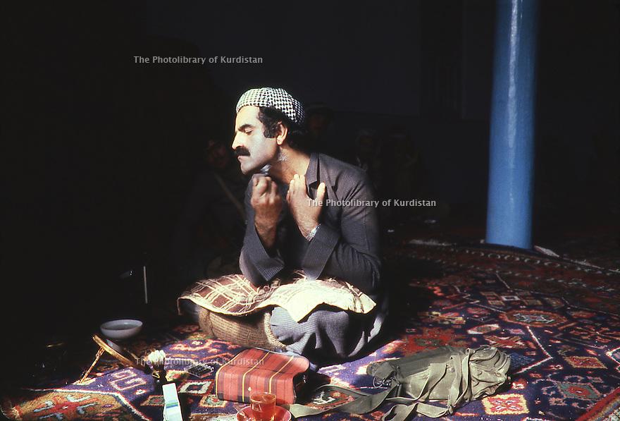 Iran 1979.Peshmerga of KDPI shaving in a mosque
