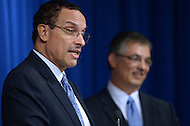 September 26, 2013  (Washington, DC)  Mayor Vincent Gray answers a question from the media during a news conference announcing the nomination of Jeffrey DeWitt (r) for CFO of the District of Columbia.  (Photo by Don Baxter/Media Images International)