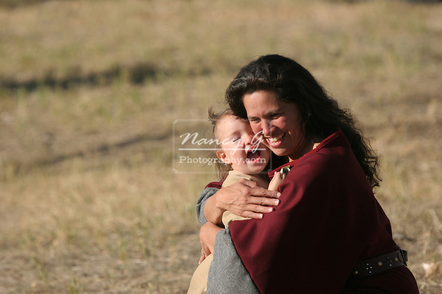 A Native American Indian Mother hugging her baby girl