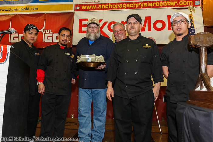 Mark Nordman accepts on behalf of Jeff King the Millenium Alaskan hotel first musher to the Yukon award presented by Patrick Cashman, Bobby Sidro, Mike DelRosario, Jerome Hermono and Jorge Martinez-Reyes at the musher 's finishers banquet in Nome on Sunday March 16 after the 2014 Iditarod Sled Dog Race.<br /> <br /> PHOTO (c) BY JEFF SCHULTZ/IditarodPhotos.com -- REPRODUCTION PROHIBITED WITHOUT PERMISSION