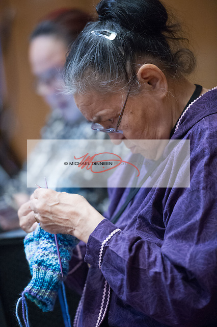 Mary Ayunerak of Alakanuk knits socks as she listens to the convention.  Photo for the Journal by Michael Dinneen