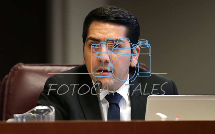 Nevada Assemblyman Nelson Araujo, D-Las Vegas, works in committee at the Legislative Building in Carson City, Nev., on Wednesday, April 29, 2015. <br /> Photo by Cathleen Allison