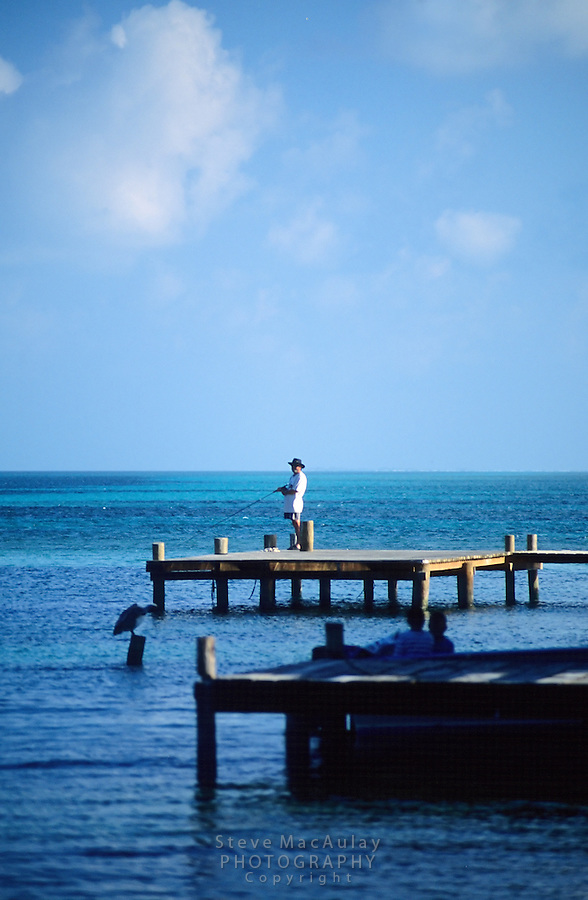 Fishing from the dock, Tobacco Caye, Belize